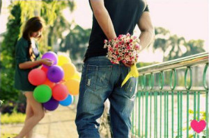 guy-giving-flowers-to-girl-girl-holding-balloons